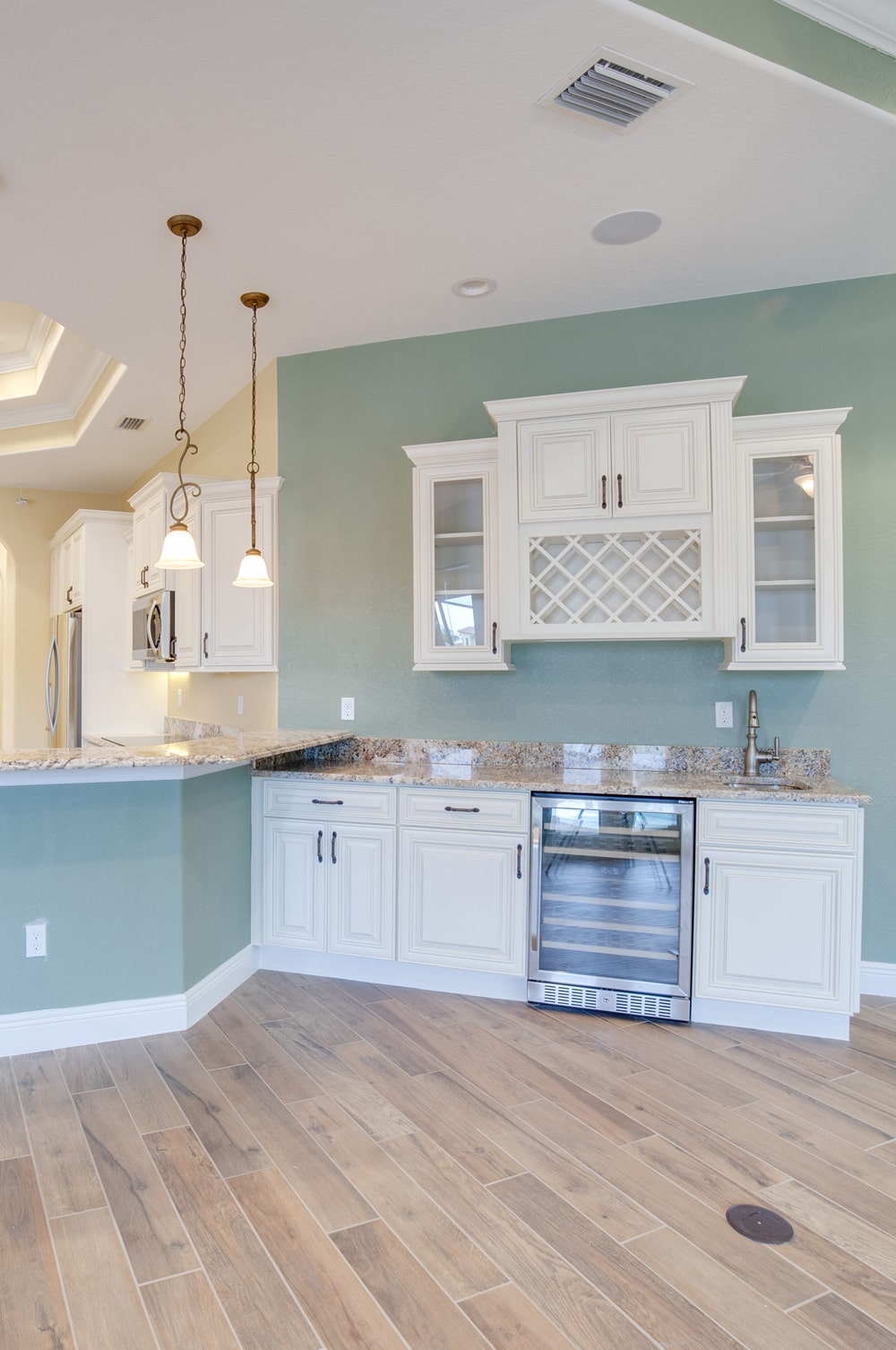 Del Prado Custom Home Builder Cape Coral Indoor Wet Bar Area and Kitchen