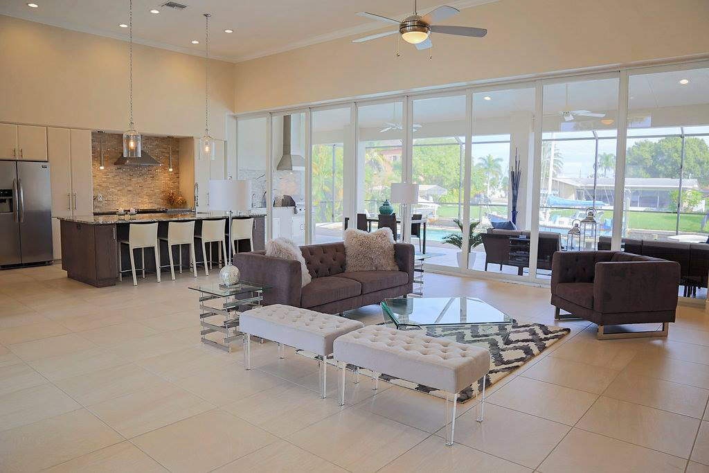 Pelican Cape Coral Custom Home Builder Kitchen and Living Room